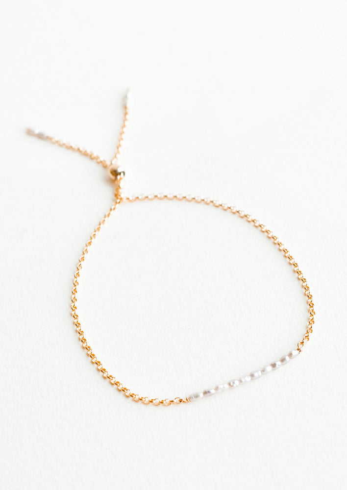 Freshwater Pearl: A delicate gold chain bracelet featuring a row of miniature freshwater pearls.
