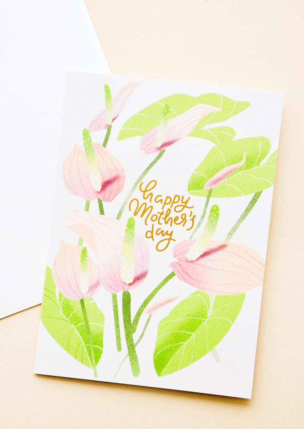 "1: Greeting card with painted anthurium stems and ""happy mothers day"" written in gold. Shown with white envelope."