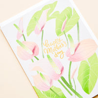 "2: Greeting card with painted florals and ""Happy Mothers Day"" written in gold."