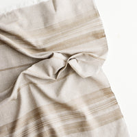 Toasted Wheat: A crumpled brown cotton towel with textured stripe and fringe edge.