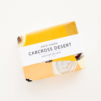 Carcross Desert: A bar of soap in patterned orange packaging with a white horizontal label.