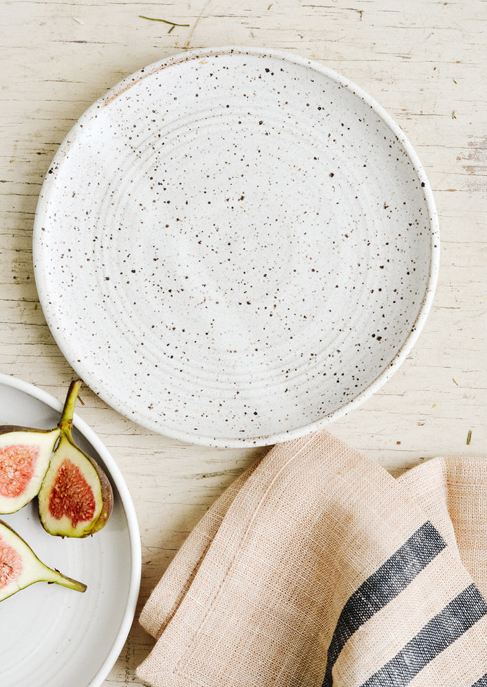 Speckled White / Side Plate: A ceramic side plate in matte white with dark speckles.