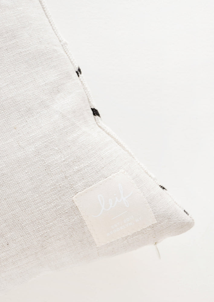 3: Logo Detail on Linen Pillow Backing - LEIF