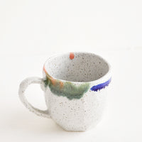 8 oz [$22.00]: A short gray ceramic mug with blue, green, and pink painted rims.