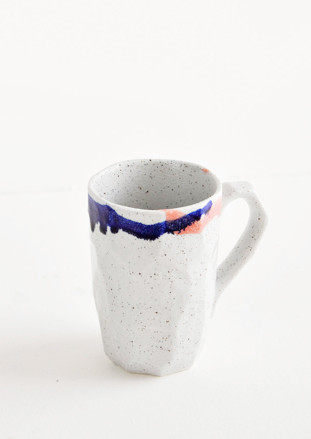 12 oz [$24.00]: A tall gray ceramic mug with blue, green, and pink painted rims.