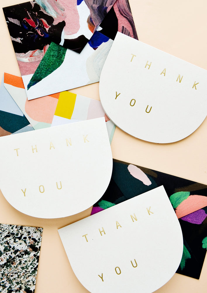 1: Thank you greeting cards in curved shape with golden letters, paired with abstract envelopes