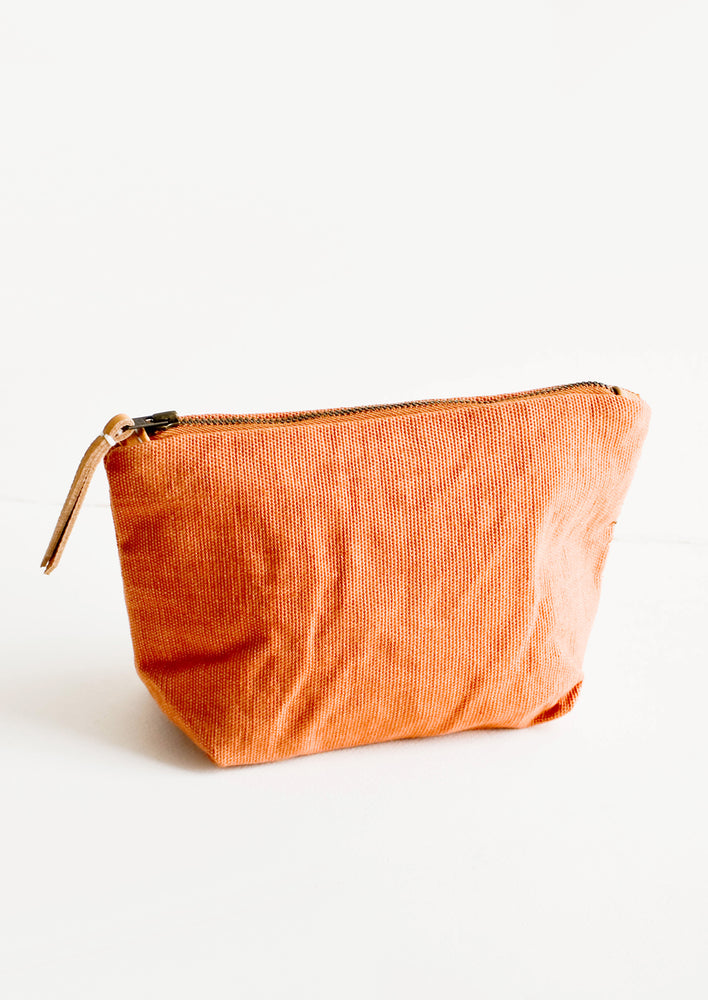Mojave Canvas / Small: Cotton toiletry pouch in rust colored canvas-like fabric. Zippered top with leather pull.