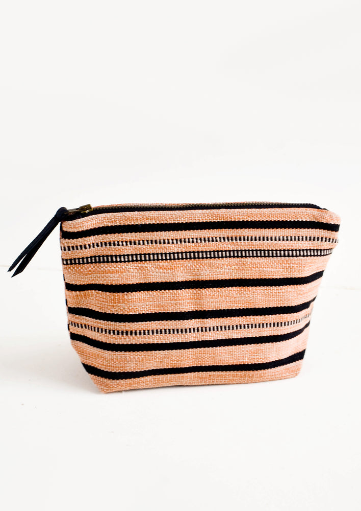 Adobe & Black Stripe / Small: Cotton toiletry pouch in rust and black striped fabric. Zippered top with leather pull.