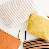 1: Assortment of cotton toiletry pouches with leather zipper pulls