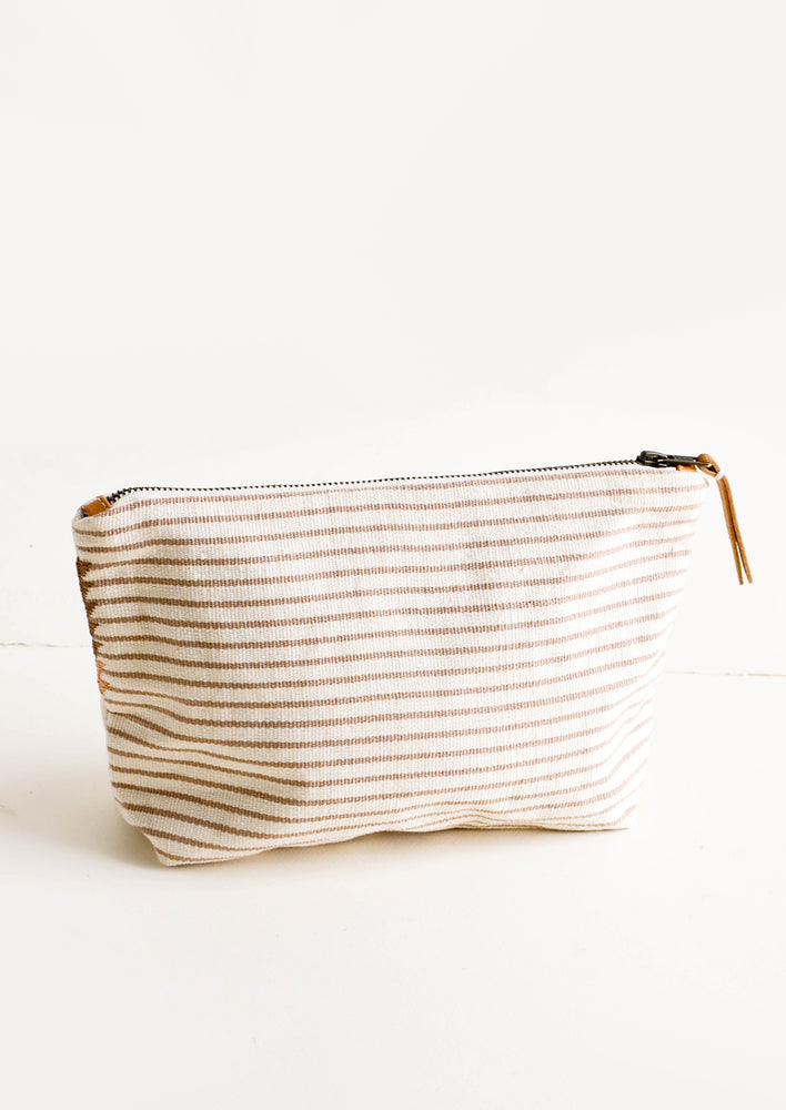 Natural Oak Stripe / Small: Cotton toiletry pouch in tan & ivory striped fabric. Zippered top with leather pull.