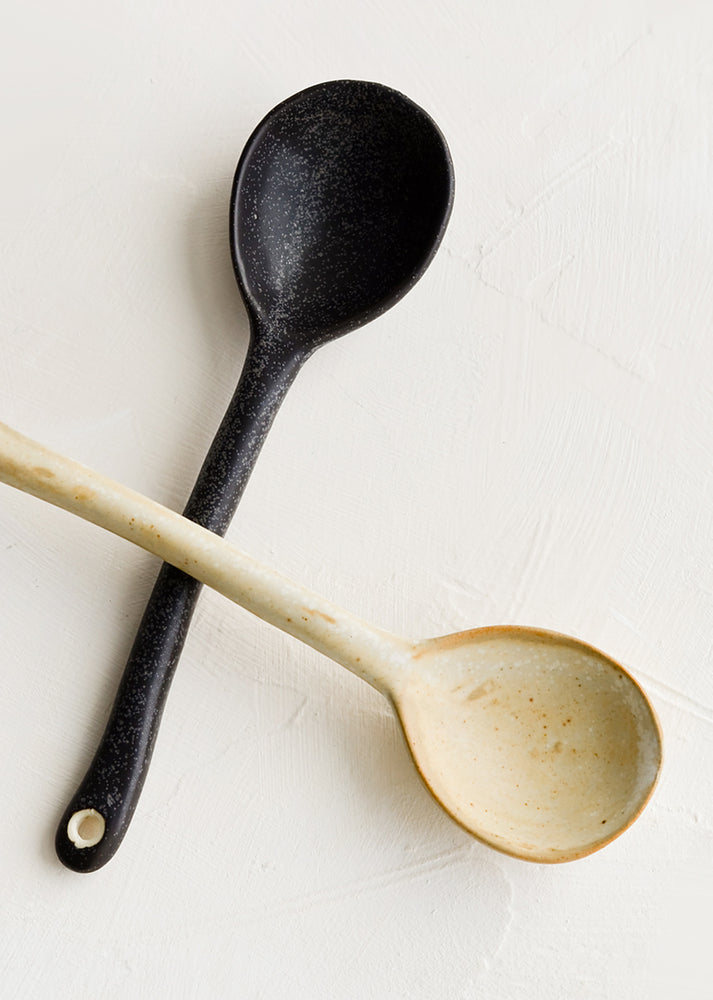 1: Ceramic spoons, one in black, one in natural.
