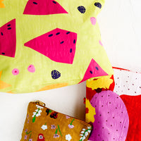 1: Three fruit and floral print nylon pouches in small, medium and large sizes.