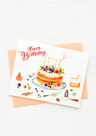 "Greeting card with cake surrounded by baking equipment, ""Happy Birthday"" script in red letters."