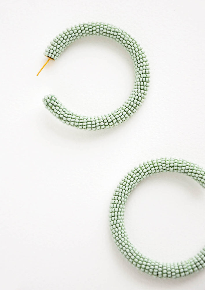 Mint: Thick hoop earrings of mint green colored glass beads.
