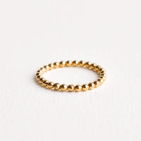 1: Yellow gold beaded ball ring.