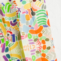Single / Large: A beeswax wrap in abstract multicolor print.