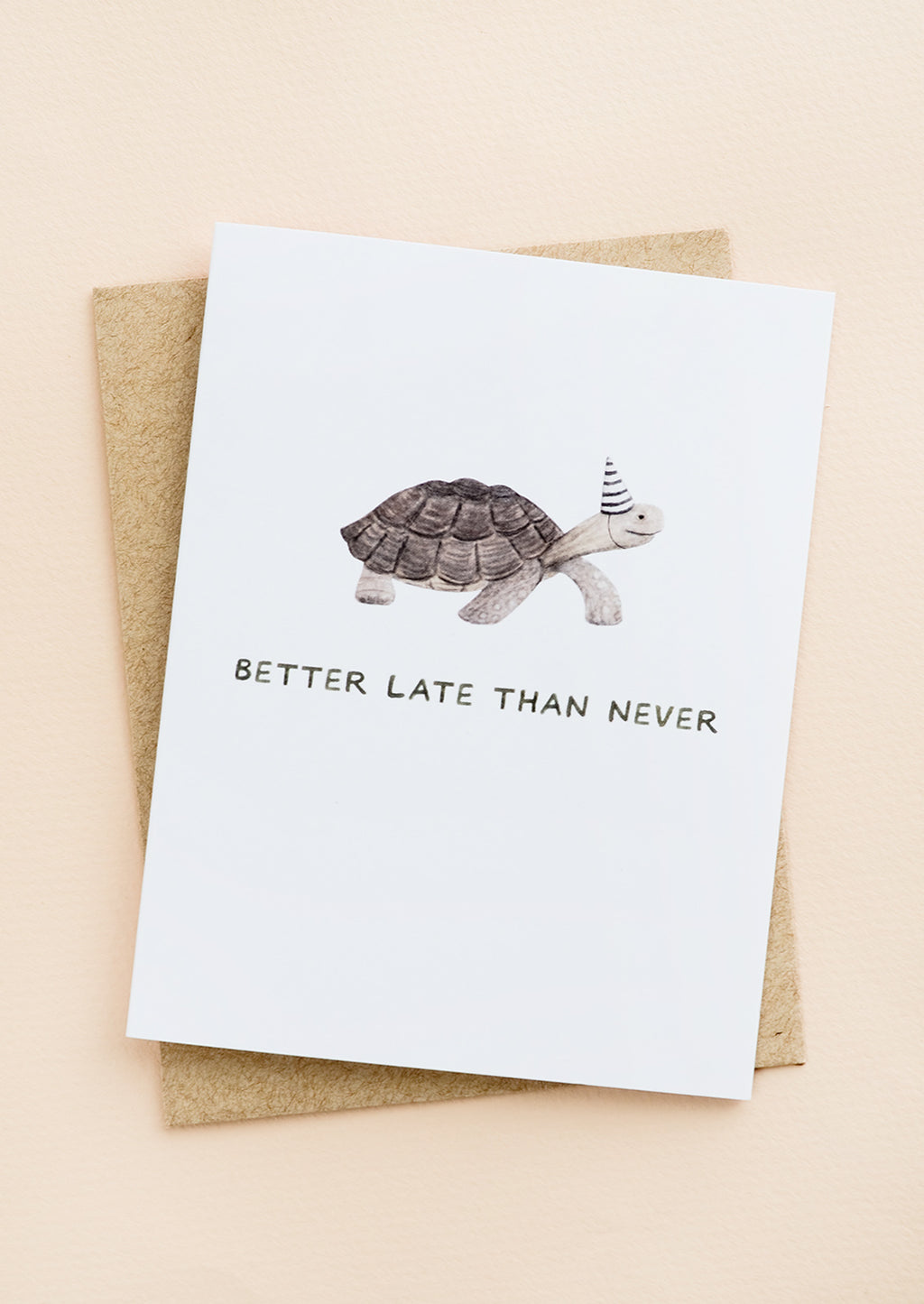 "1: A greeting card with illustration of a tortoise in a party hat, text underneath reads ""Better late than never""."