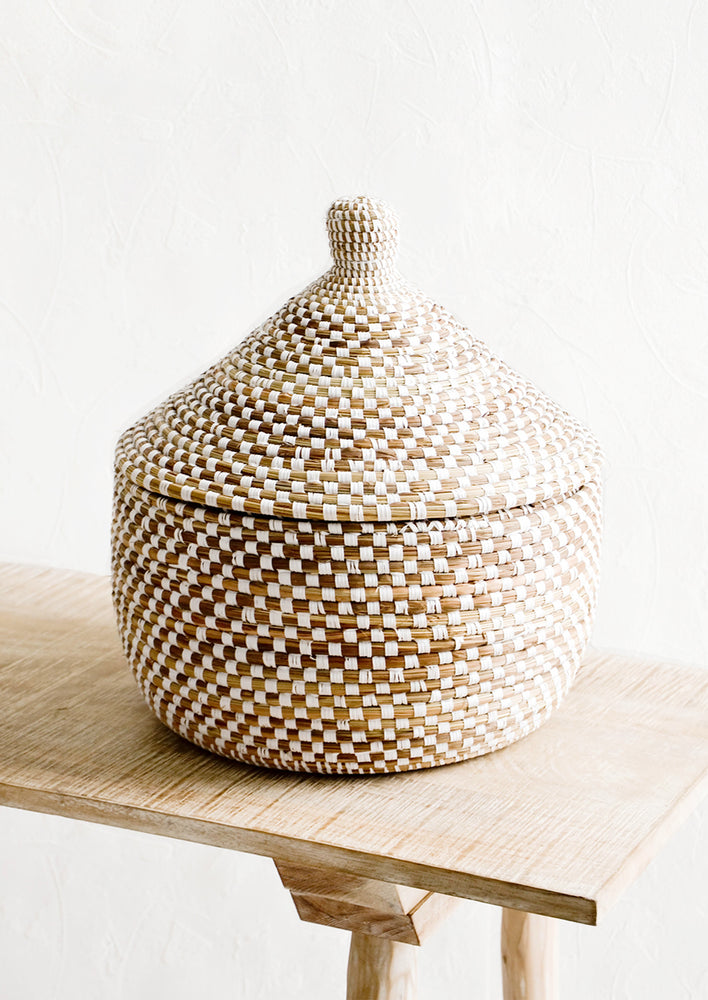 3: Lidded storage basket made from natural grass with white checkered pattern