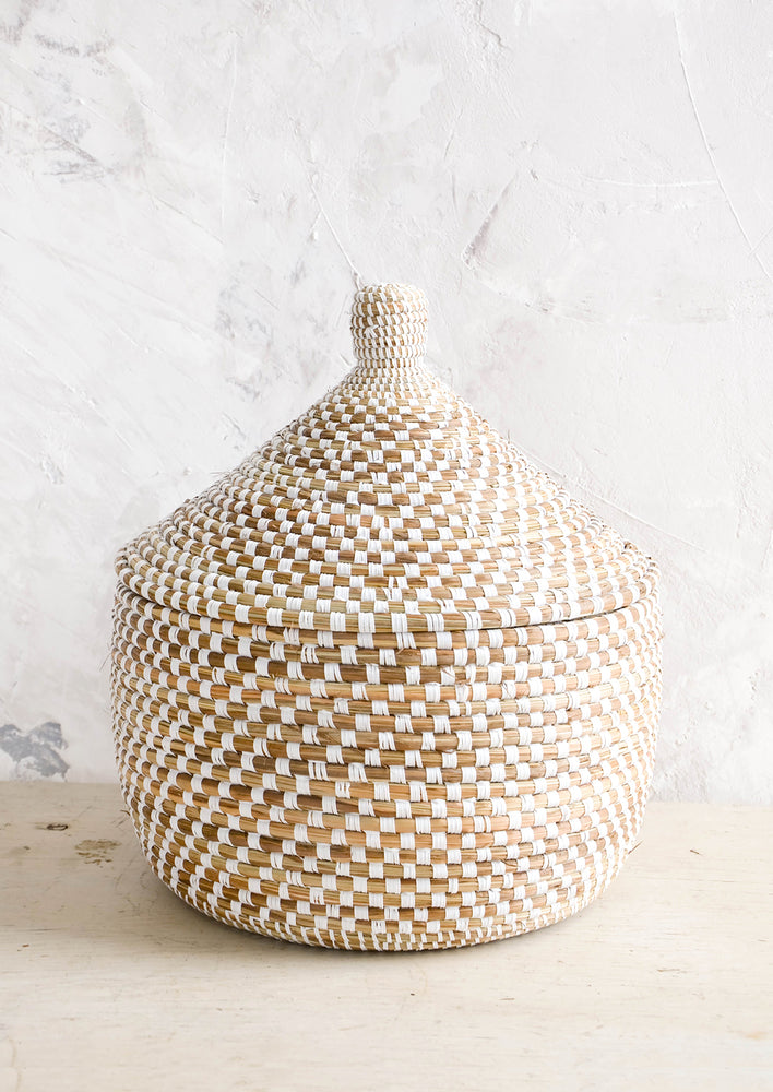 2: Lidded storage basket made from natural grass with white checkered pattern