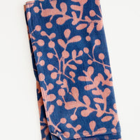 Petrol: Block print cotton dinner napkin in blue with pink leaf print