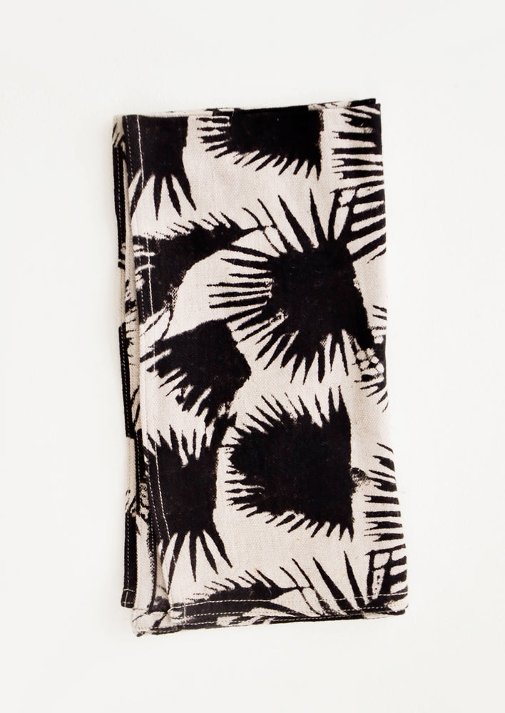Tan: Block print cotton dinner napkin in beige with black palm leaf print