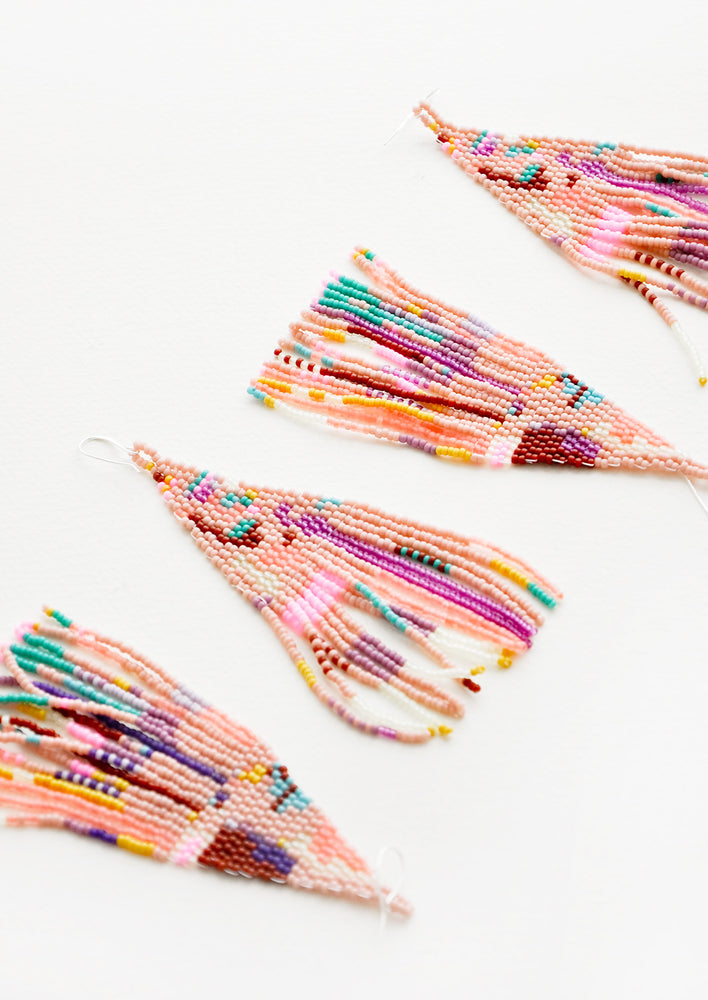 3: Four pink multicolored beaded fringe earrings.