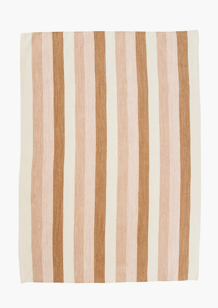 1: A striped cotton rug in pink, brown and ivory.