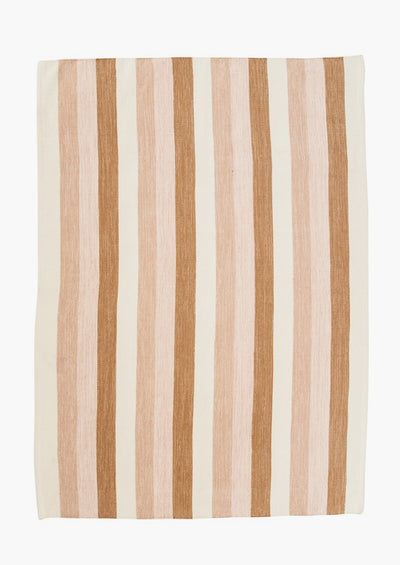 A striped cotton rug in pink, brown and ivory.