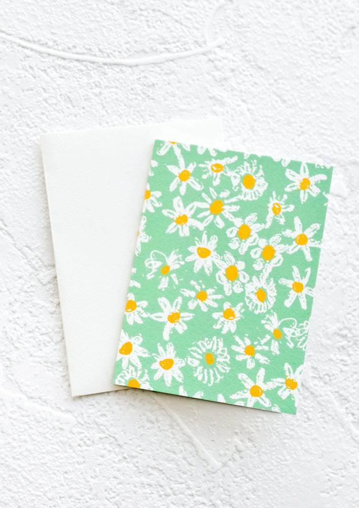 Green Daisies: A gift enclosure greeting card with a green background and daisy print.