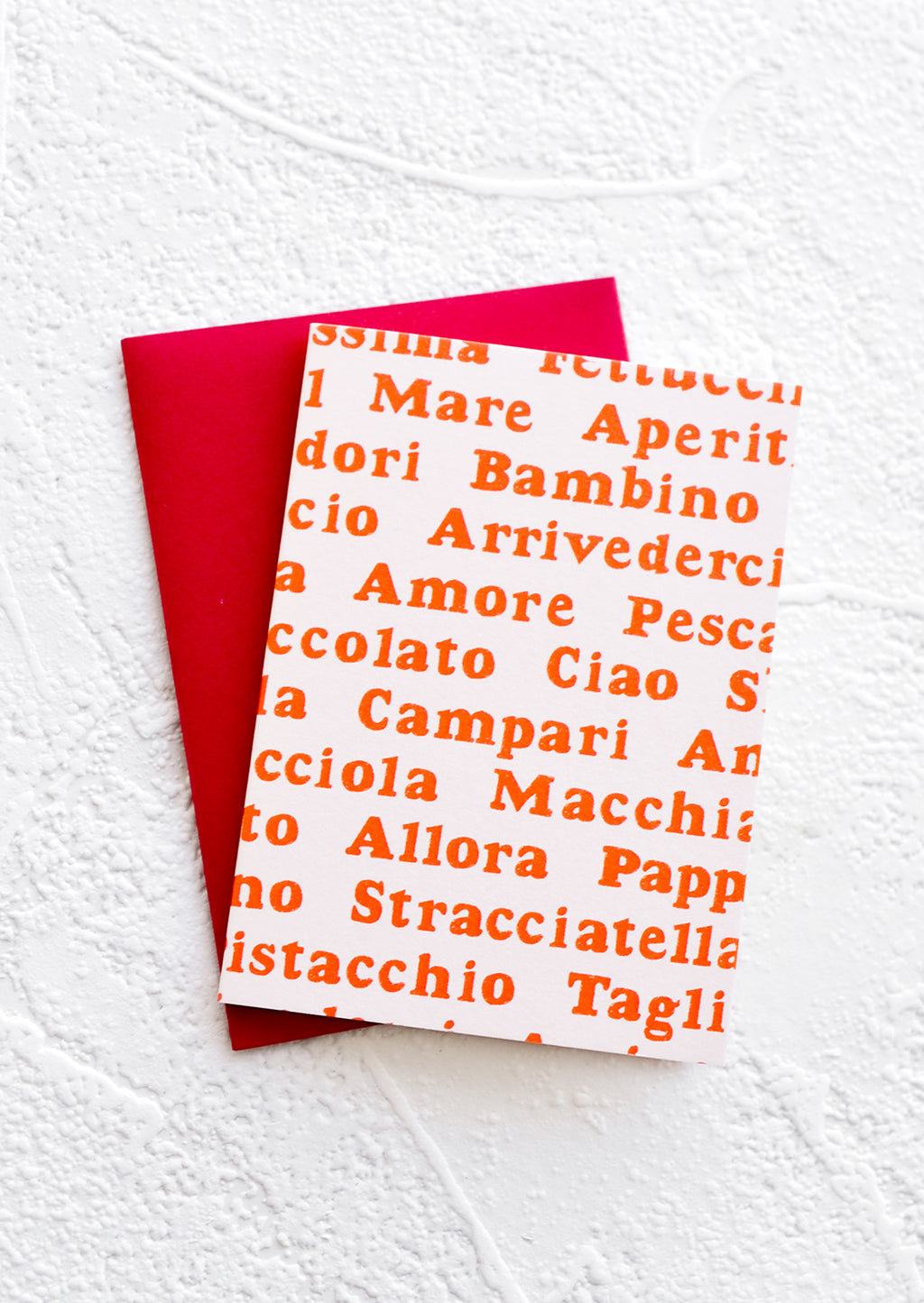Parli Italiano?: A gift enclosure greeting card with a pale pink background and Italian words printed in red text.