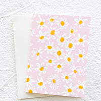 Pink Daisies: A gift enclosure greeting card with a pink background and daisy print.