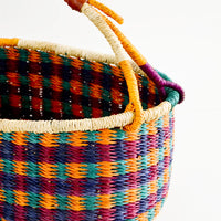 2: Woven basket made from multicolor dyed elephant grass with leather wrapped carrying handle