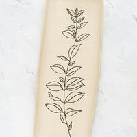 Bay Laurel: A long and skinny ceramic tray in natural bisque color with an etched black drawing of a Bay Laurel plant.