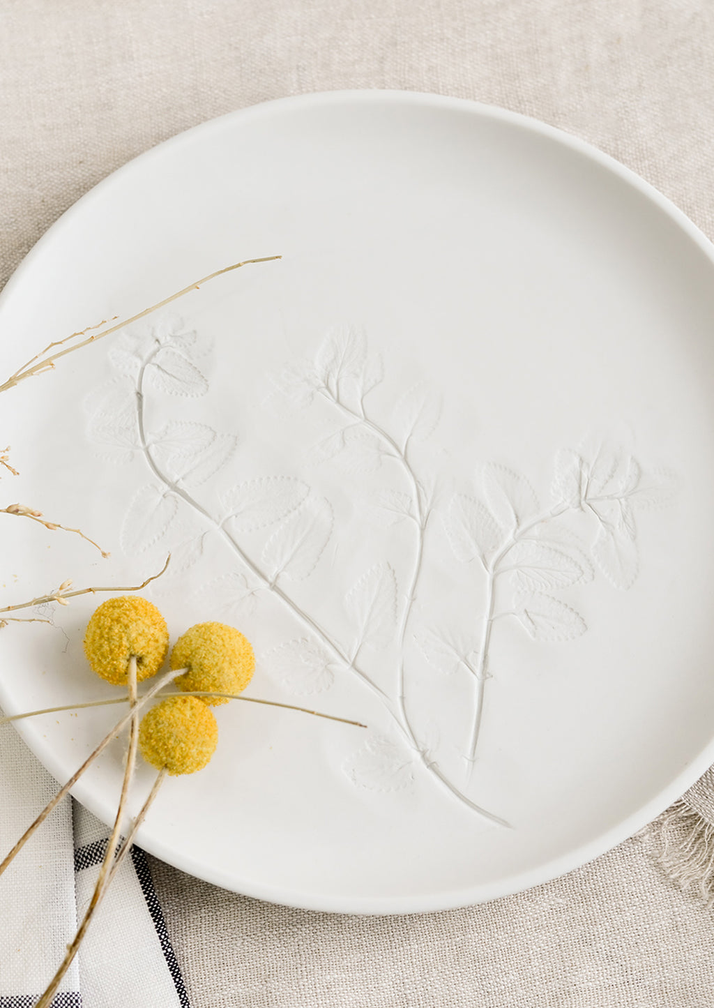 Large / Porcelain: A white porcelain plate with impression of mint leaves.
