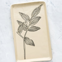 Bellwort: A rectangular ceramic tray in natural bisque color with an etched black drawing of Bellwort plant.