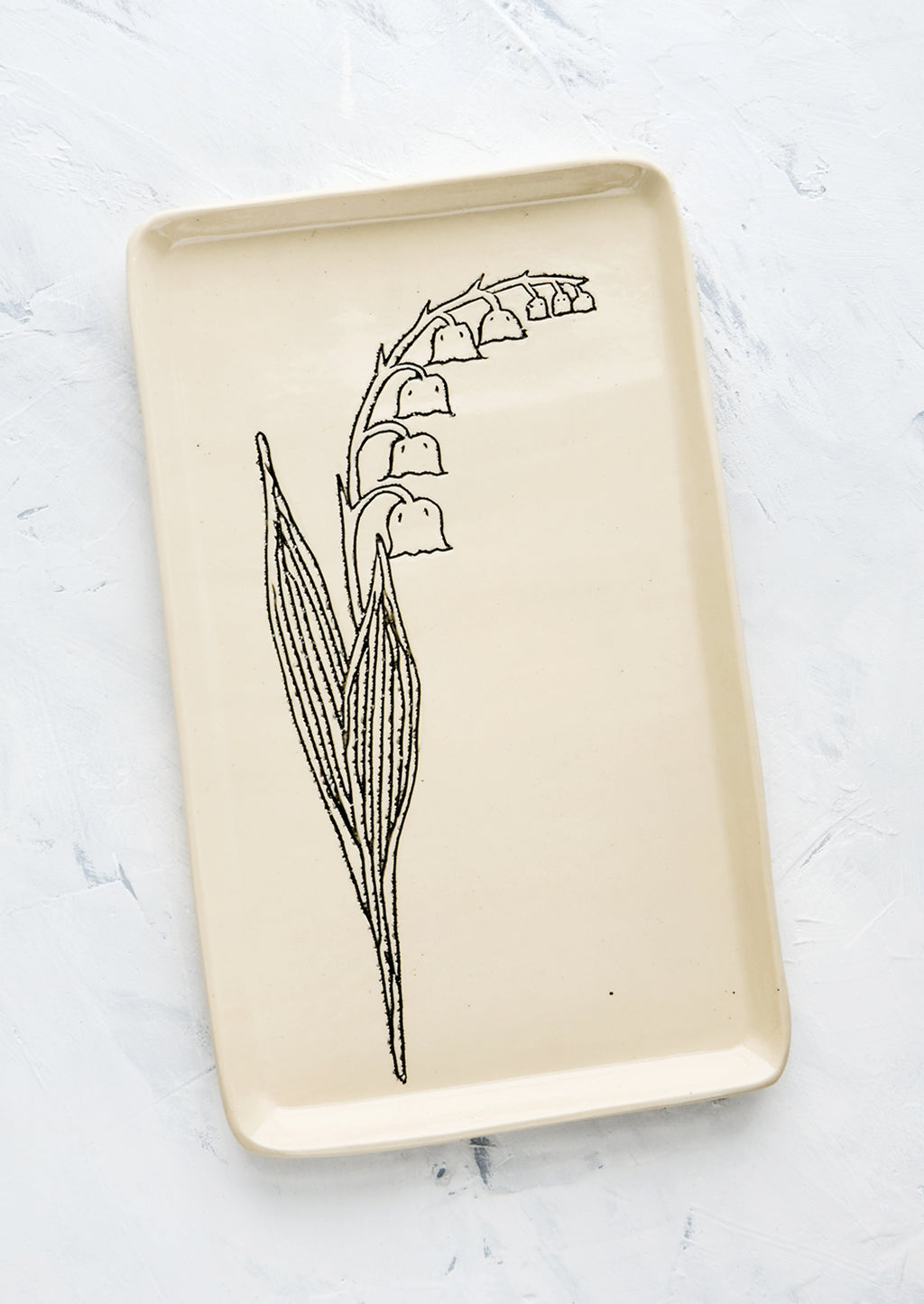 Lily of the Valley: A rectangular ceramic tray in natural bisque color with an etched black drawing of Lily Of the Valley flower.