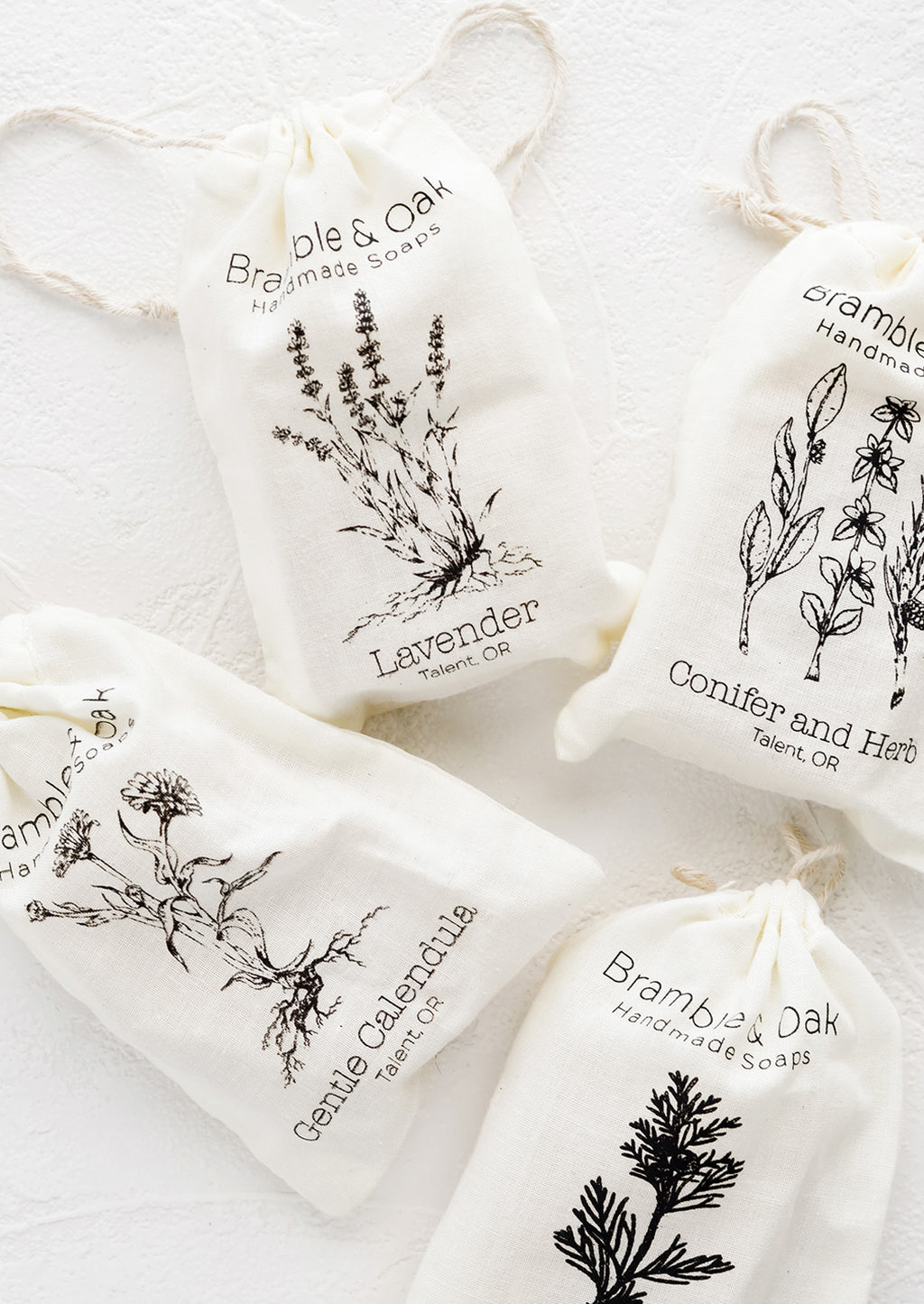 Lavender: Muslin bag packaging for bar soap with botanical imagery.