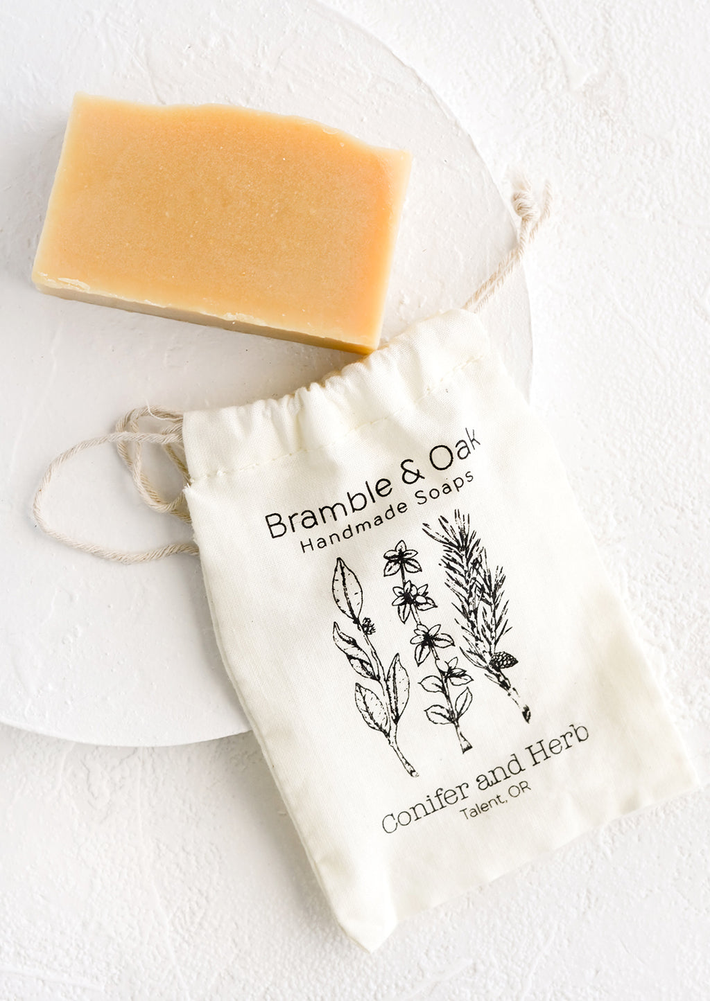 Conifer & Herb: A printed muslin bag with a bar of soap.