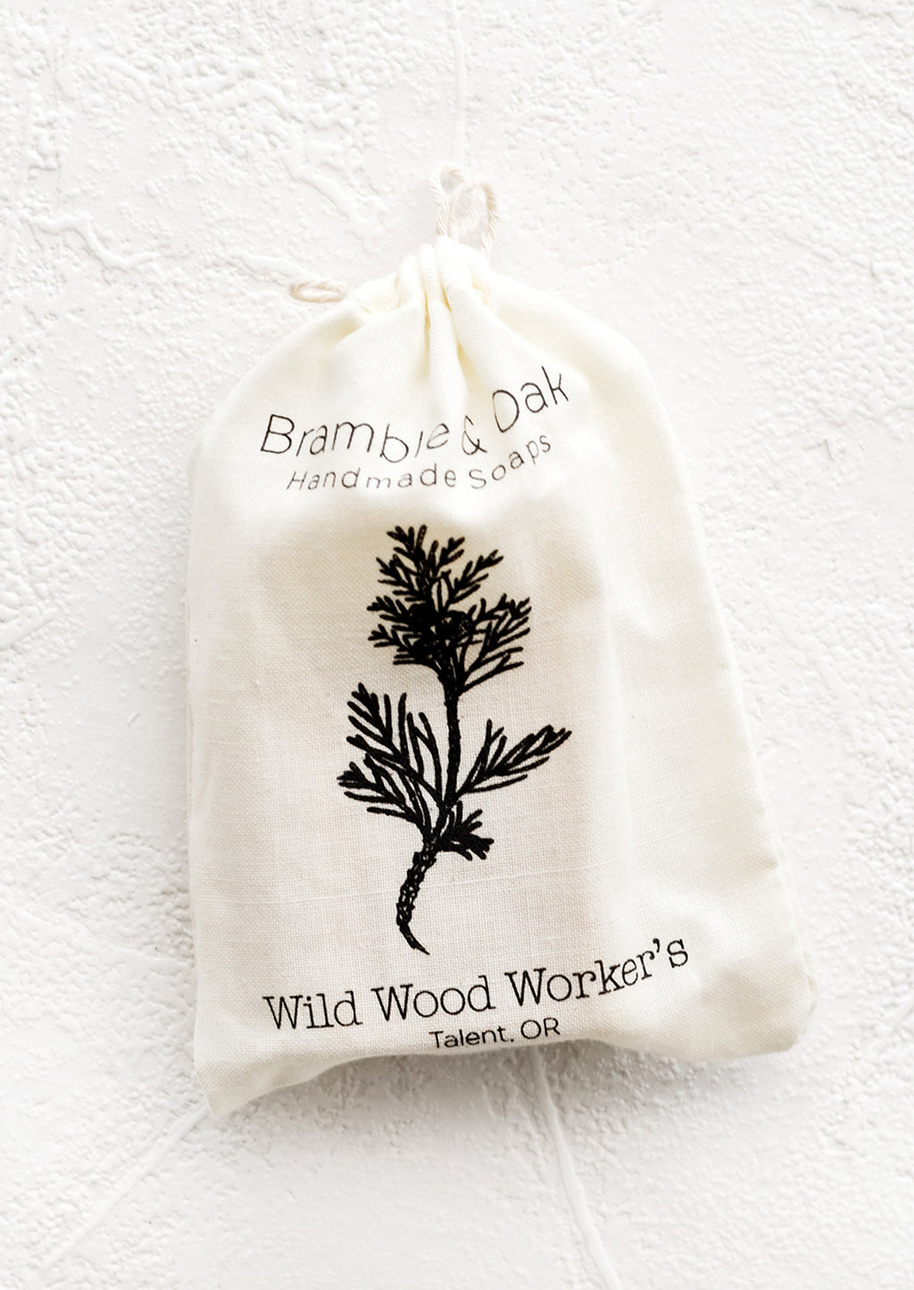 Wild Wood Worker's: A printed muslin bag with botanical imagery.