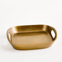 1: Square catchall tray in unpolished brass with raised sides, cutout handles at two sides