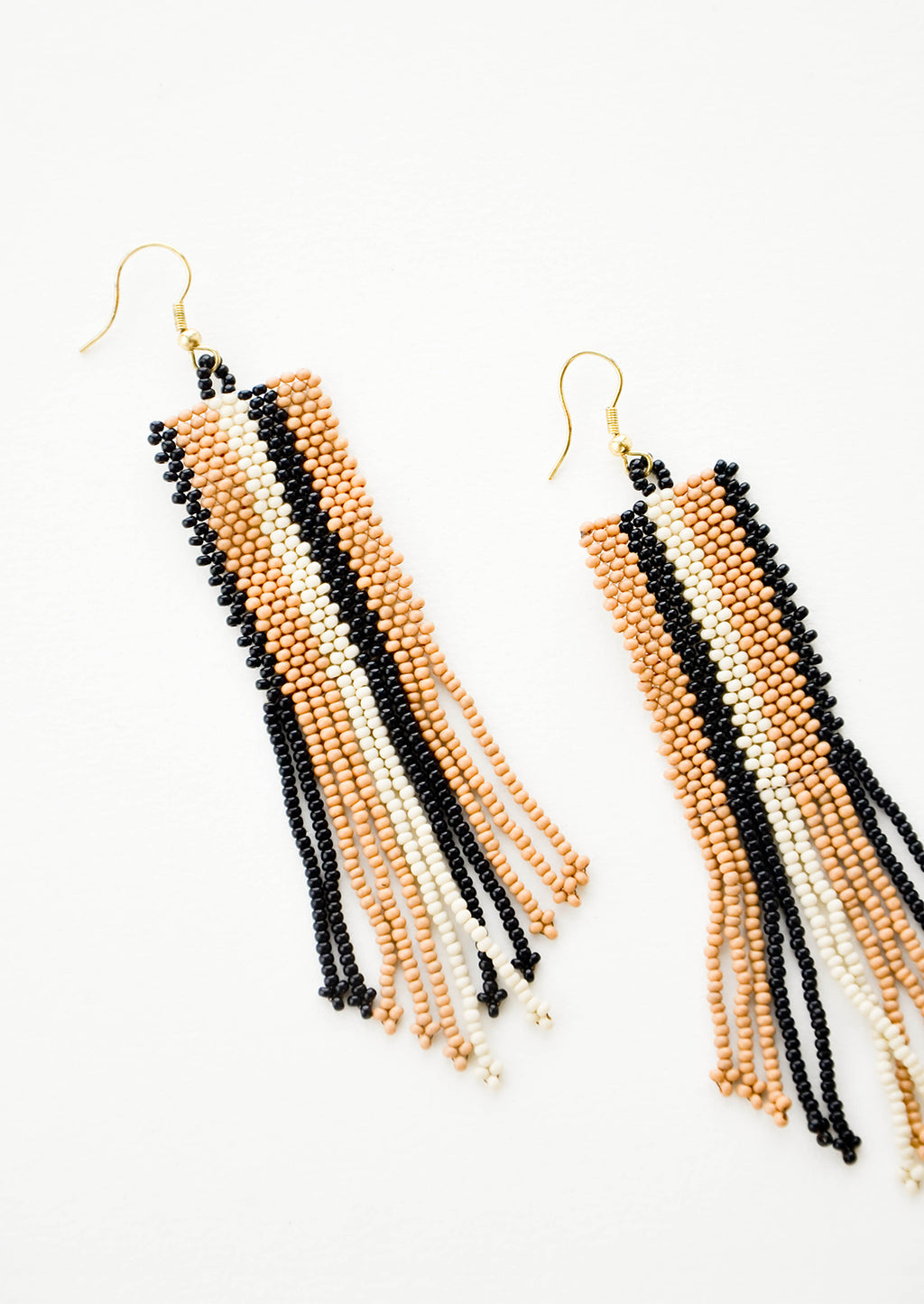 1: Long rectangular beaded fringe earrings with a pattern of black, brown, and white stripes.