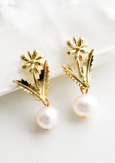 Gold flower earrings with pearl bead.