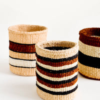 2: Small, round storage baskets in an assortment of striped patterns