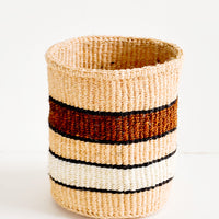 1: Small, round storage basket in striped pattern of peach, brown and white