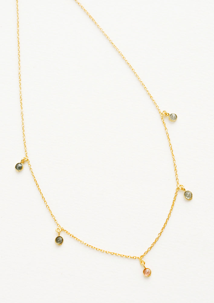 Tourmaline: Yellow gold chain necklace with 5 small dangling multicolored gemstones.