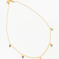 1: Yellow gold chain necklace with 5 small dangling white gemstones.