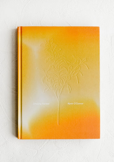 A hardcover cookbook with orange and yellow cover