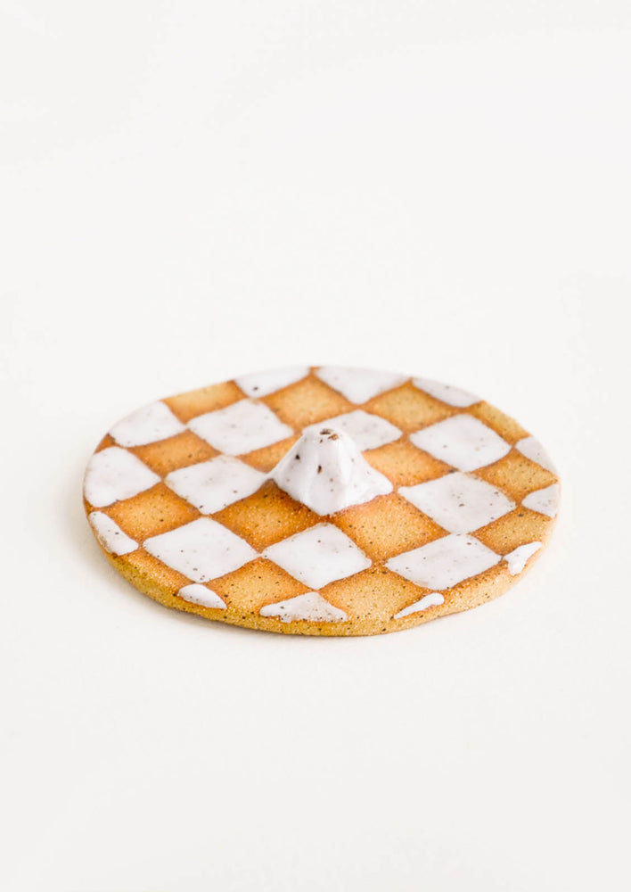1: Handmade ceramic incense holder in checkered pattern