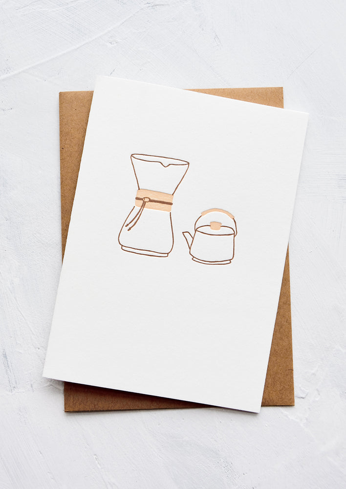 1: A letterpress printed greeting card with an image of a chemex coffee pourover and a kettle