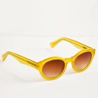 2: Yellow sunglasses with oval tinted lenses.